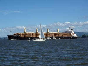 timber barge and sailboat