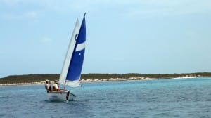 small boat sailing bahamas
