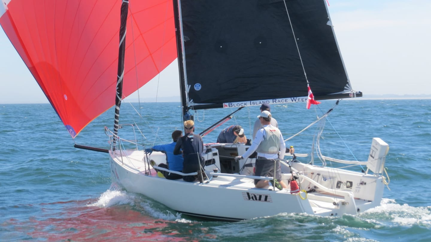 J/80 Racing Sailboat Flying an Asymmetric Spinnaker